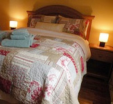 Bedroom at Above the Tickle with a queen bed and duvet with 400 thread count linens