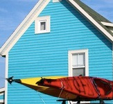Above the Tickle exterior with kayaks in Twillingate